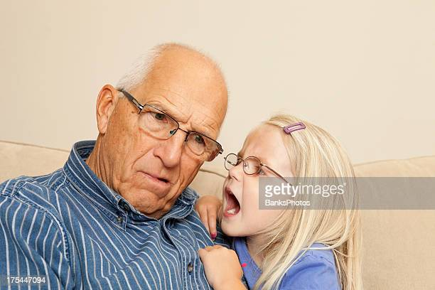 Child Girl Yelling into Grandfather's Ear