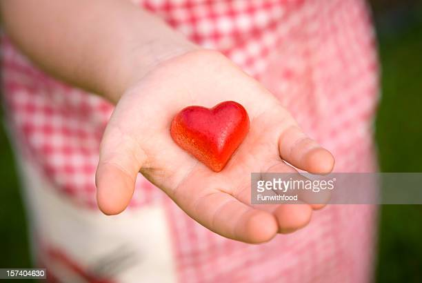 Child Giving Heart Valentine's Day Food, Hand Holding Chocolate Candy