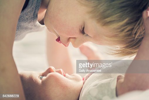 Child giving his baby Sister a kiss