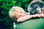 Child giving his Grandpa a hug
