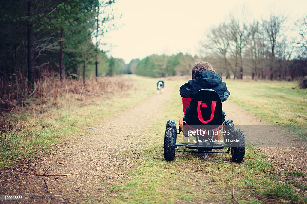 Child Go Karting in the woods : Stock Photo