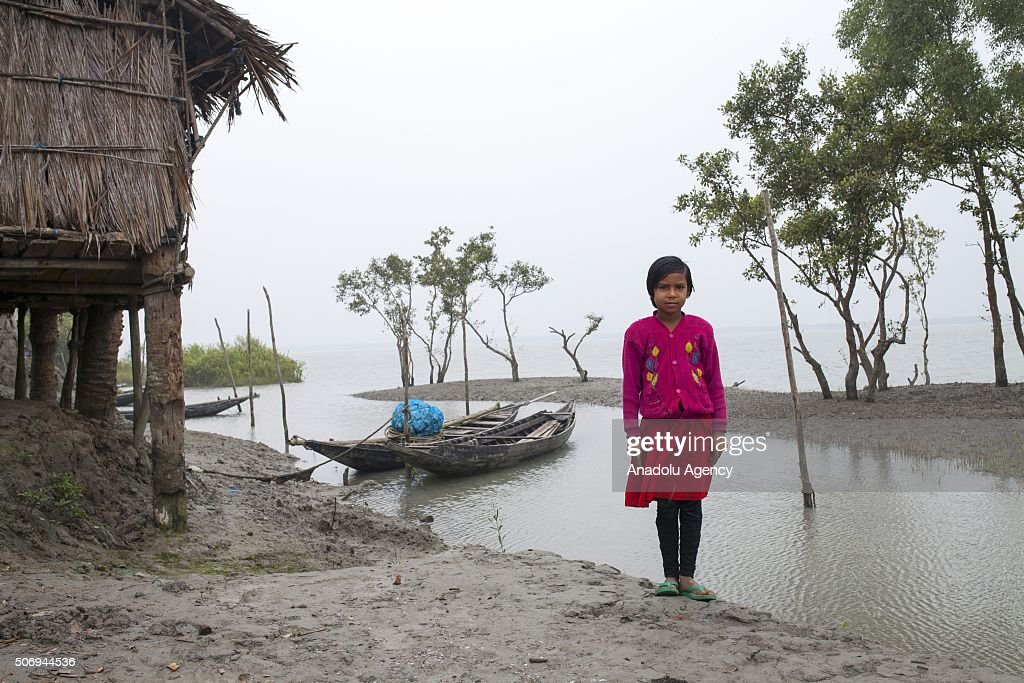 Child goes to school after the rise of sealevel as Department of Environment's study conducted between April 2013 and Oct 2015 which analyzed tidal...
