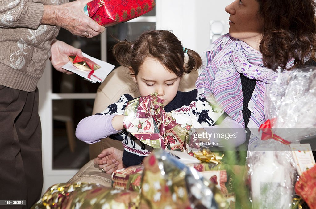 child grabs here gifts and presents : Stock Photo