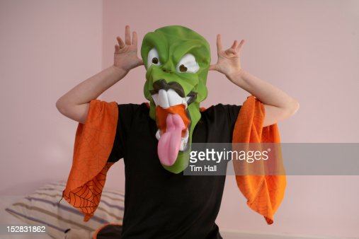 Child grimacing in Halloween costume : Bildbanksbilder