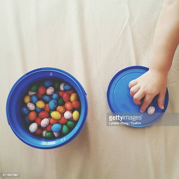Child hand picking candy