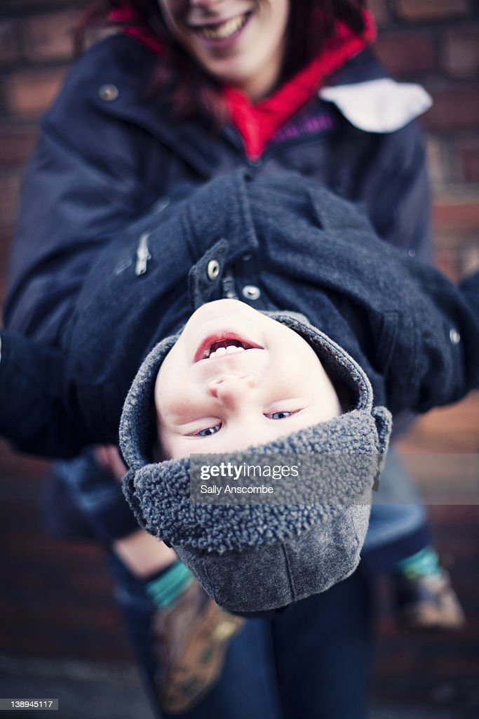 Child Hanging Upside Down Stock Photo | Getty Images
