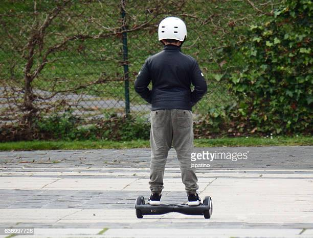 Child having fun with an Two-wheel electric skate