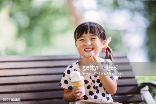 Child having ice-cream in park joyfully