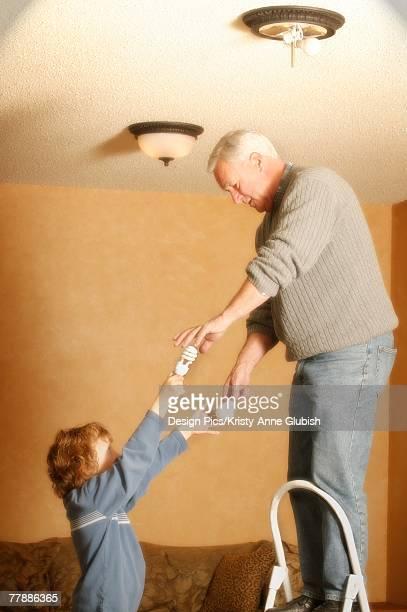 Child helping grandparent
