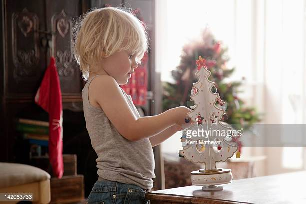 child helping with christmas decorations