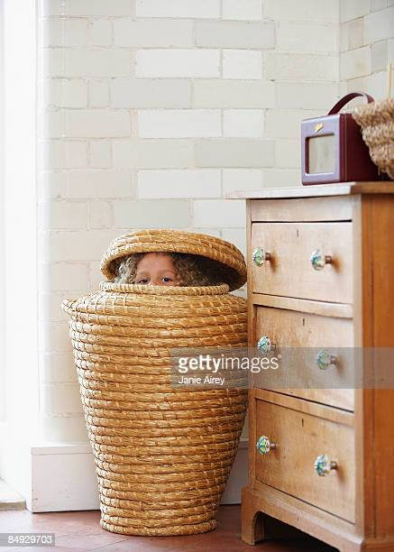 Child hiding in laundry basket