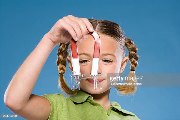 Child holding a magnet