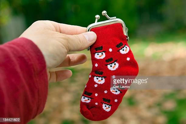 Child holding Christmas stocking purse