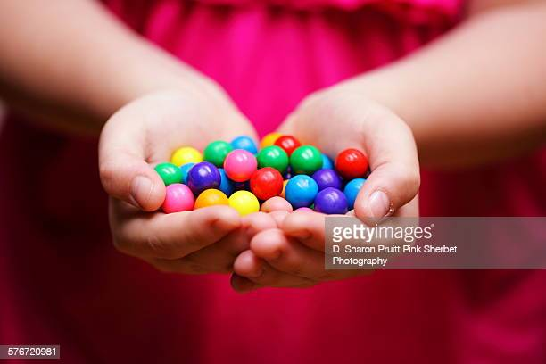Child Holding Colorful Gum Balls