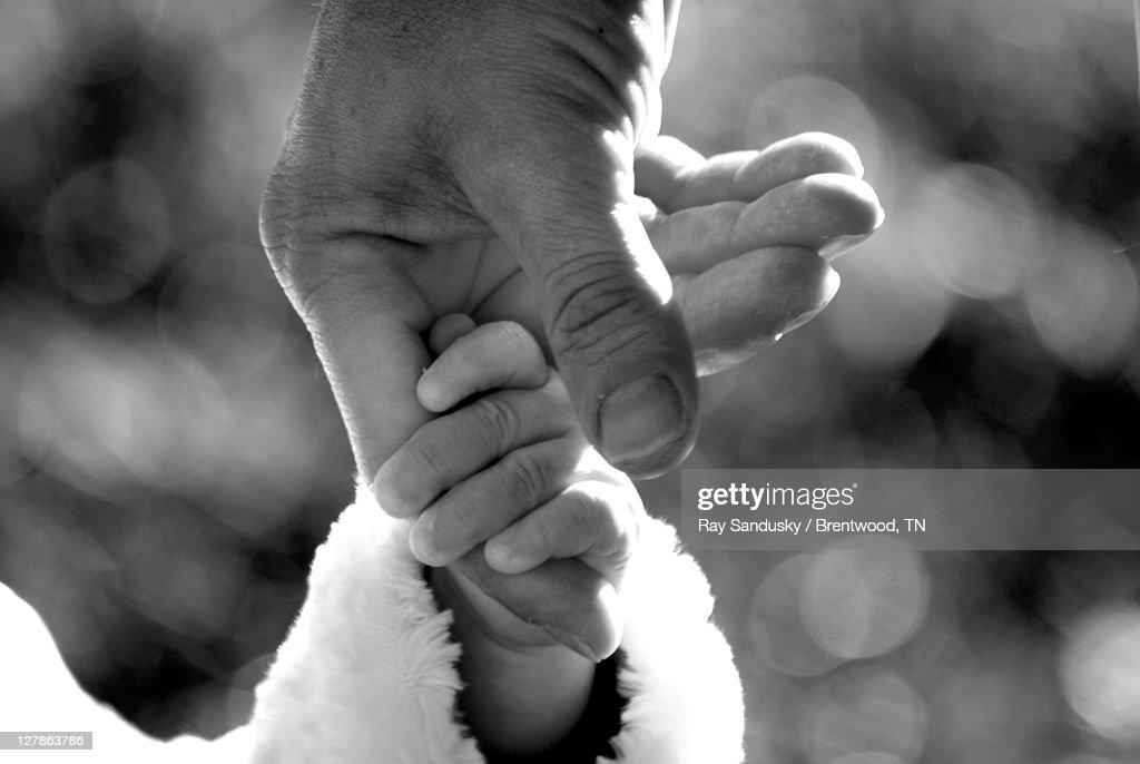Child holding finger