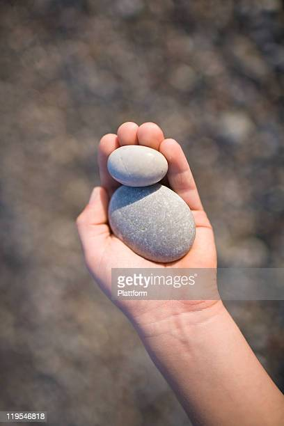 Child holding pebbles