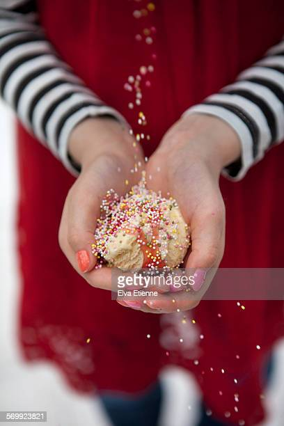 Child holding scoop of ice cream in hands