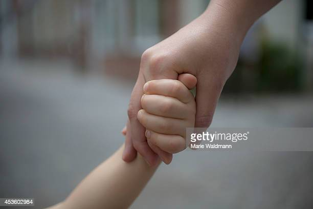 Child holding the hand of her mother on July 16 in Berlin Germany