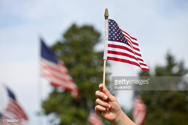 Child holding the United States Flag