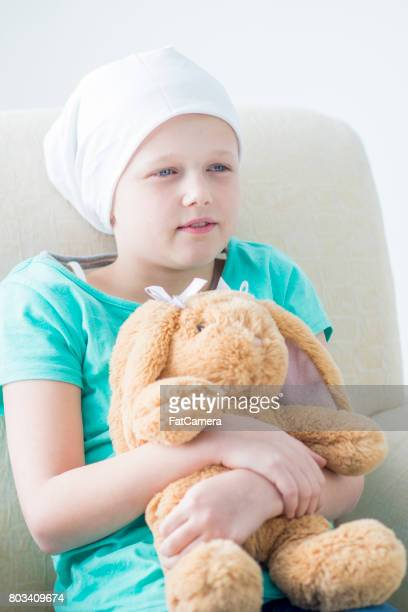 Child Holding Toy at Doctors