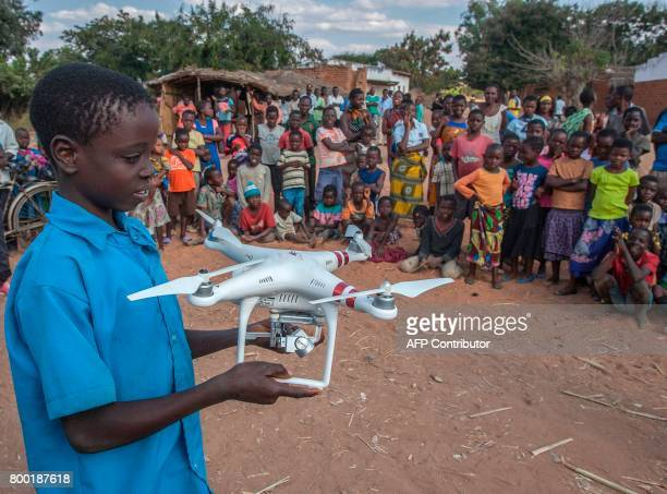 A child holds a drone during a drone awareness and safety demonstration on June 22 in regards to humanitarian drone corridor testing under the...