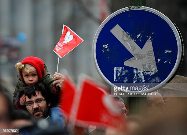 A child holds a flag during a demonstration to condemn the government's liberalisation of the abortion laws on March 7 2010 in Madrid Spain's upper...
