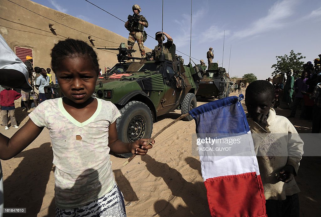 A child holds a Locals welcome French soldiers in Bourem northen Mali on February 17, 2013. Leaders in Africa's Sahel region called on Saturday for further efforts to support Mali as they announced new funds to back a West African force in the country. A French-led military intervention launched on January 11 has driven the Islamist rebels in Mali from the towns they controlled, but concerns remain over stability amid suicide attacks and guerrilla fighting. GUYOT