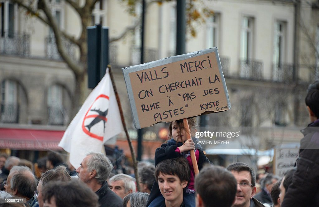 A child holds a placard during a demonstration on November 24, 2012 in Nantes, western France, to protest against a project to build an international airport, in Notre-Dame-des-Landes near Nantes. The airport, which is scheduled to replace the current airport at Nantes in 2017, is a pet project of Socialist Prime Minister Jean-Marc Ayrault, who was the city's mayor from 1989 until this year. AFP PHOTO DAMIEN MEYER