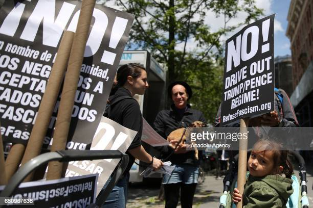 A child holds a sign as activists chant slogans against Paul Ryan speaker of the United States House of Representatives visit to Harlem Success...