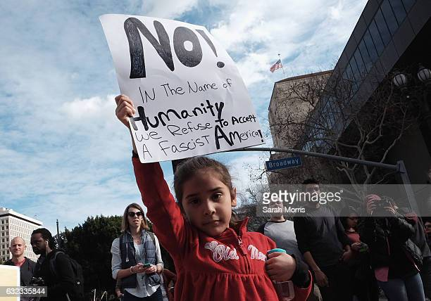 A child holds a sign during the Women's March on January 21 2017 in Los Angeles California Tens of thousands of people took to the streets of...