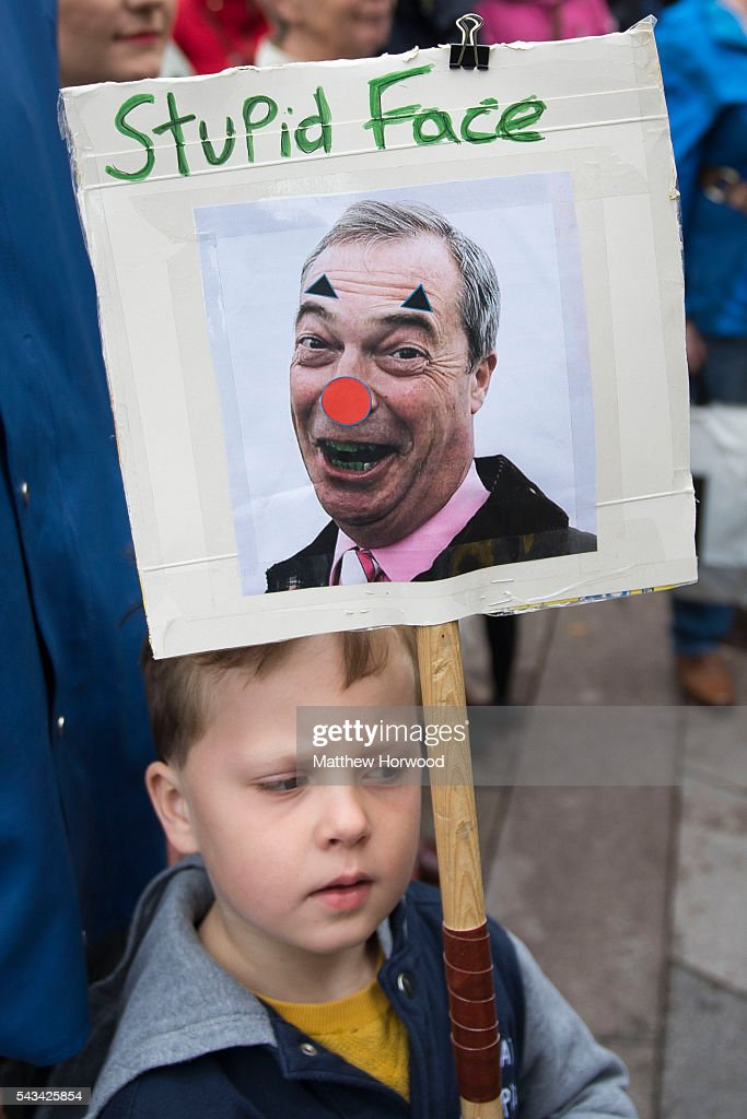 A child holds a sign showing a picture of Nigel Farage, leader of UKIP, during an anti-Brexit rally on June 28, 2016 on the Hayes in Cardiff, Wales. The protest is at a time of economic and political uncertainty following the referendum result last week, which saw the UK vote to leave the European Union.