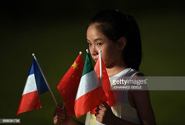 A child holds national flags of G20 member nations prior to a group photo and dinner banquet at the G20 Summit in Hangzhou on September 4 2016 World...