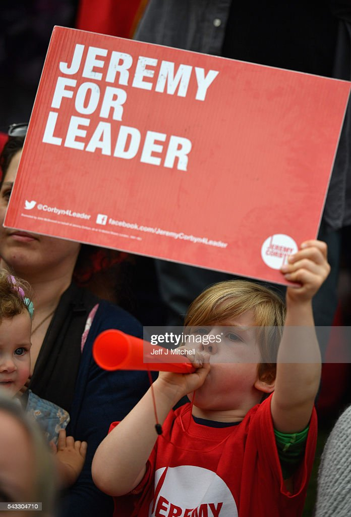 A child holds up a sign in support of Labour leader Jeremy Corbyn during Momentum's 'Keep Corbyn' rally outside the Houses of Parliament on June 27, 2016 in London, England. The Labour Leader has seen mass resignations from the Shadow Cabinet in the wake of the UK Vote for Brexit. His support group, Momentum, have recorded more than 1000 new members in the same period.