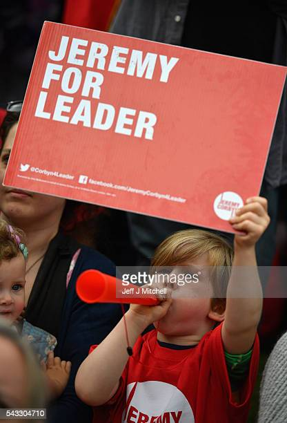 A child holds up a sign in support of Labour leader Jeremy Corbyn during Momentum's 'Keep Corbyn' rally outside the Houses of Parliament on June 27...