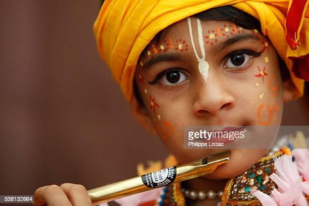 Child impersonating Hindu god Krishna at Janmashtami festival at Bhaktivedanta Manor ISKCON (Hare Krishna) temple