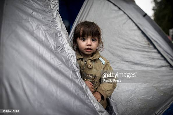 A child in a tent waiting for a chance to travel to the SerbianCroatian border and to finally enter Croatia Millions of refugees mostly children and...