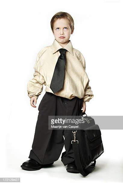 Child in baggy business suit and briefcase