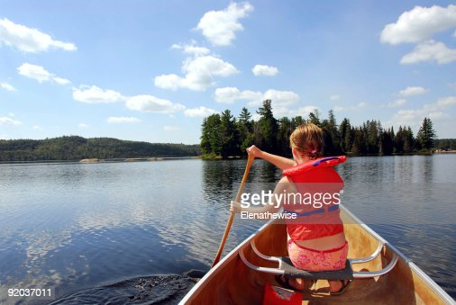 Child in canoe : Stock Photo