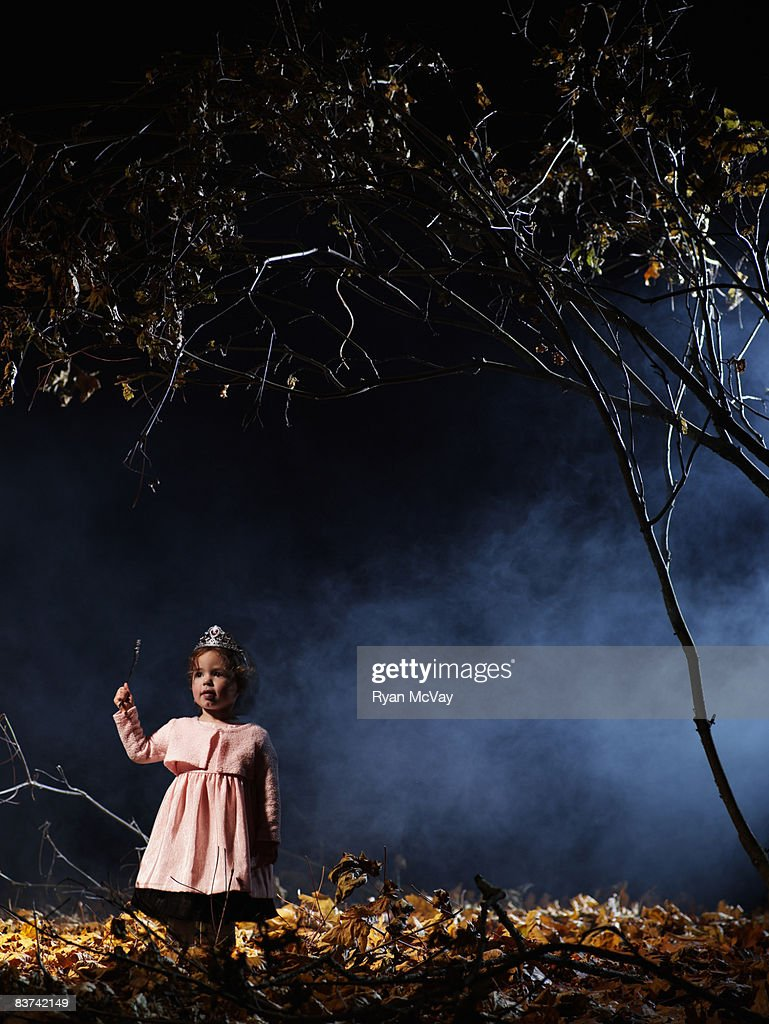 Child in costume in dark forest scene. : Stock Photo