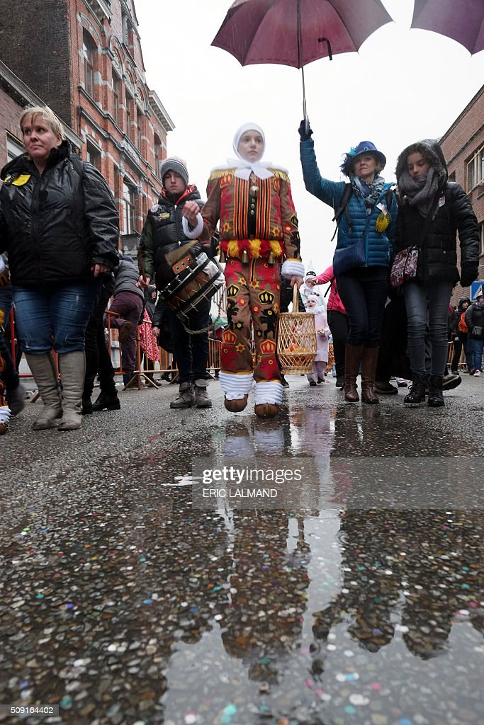 A child in costume takes part in the carnaval of Binche on February 9, 2016. The Binche Carnival tradition is one of the most ancient and representative of Wallonia and its inscribed since 2008 as on the Representative List of the Intangible Cultural Heritage of Humanity by UNESCO. / AFP / BELGA AND Belga / ERIC LALMAND / Belgium OUT