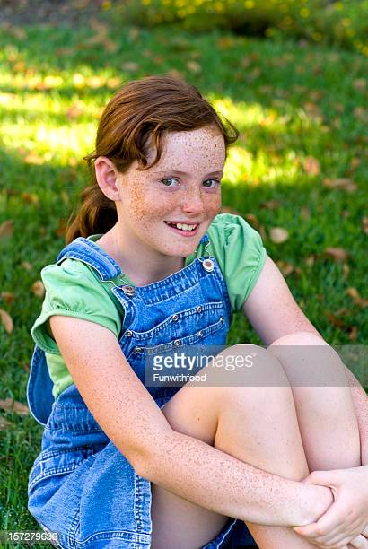 Child in Coveralls, Redhead and Freckles Girl Happy & Smiling Outdoors