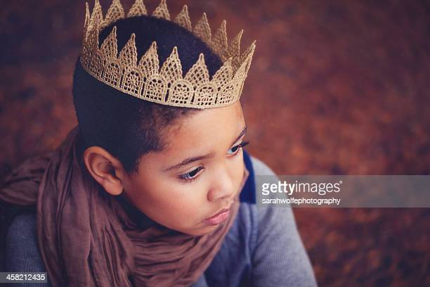 child in crown and scarf