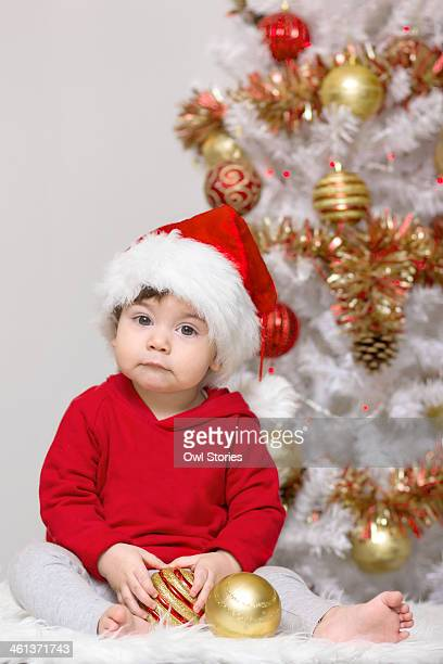 Child in front of a decorated ChristmasTree