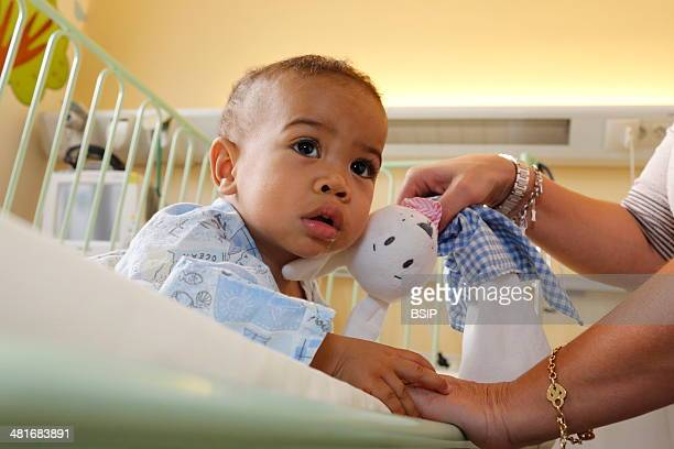 Child in hospital with his foster mother This boy from Madagascar is about to undergo heart surgery provided by French NGO La Chaine de l'Espoir