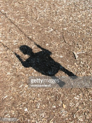 Child in Swing Shadow