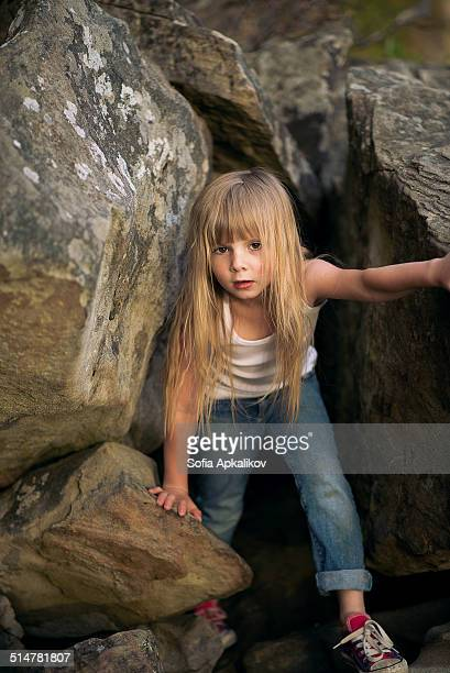 Child in the rocks