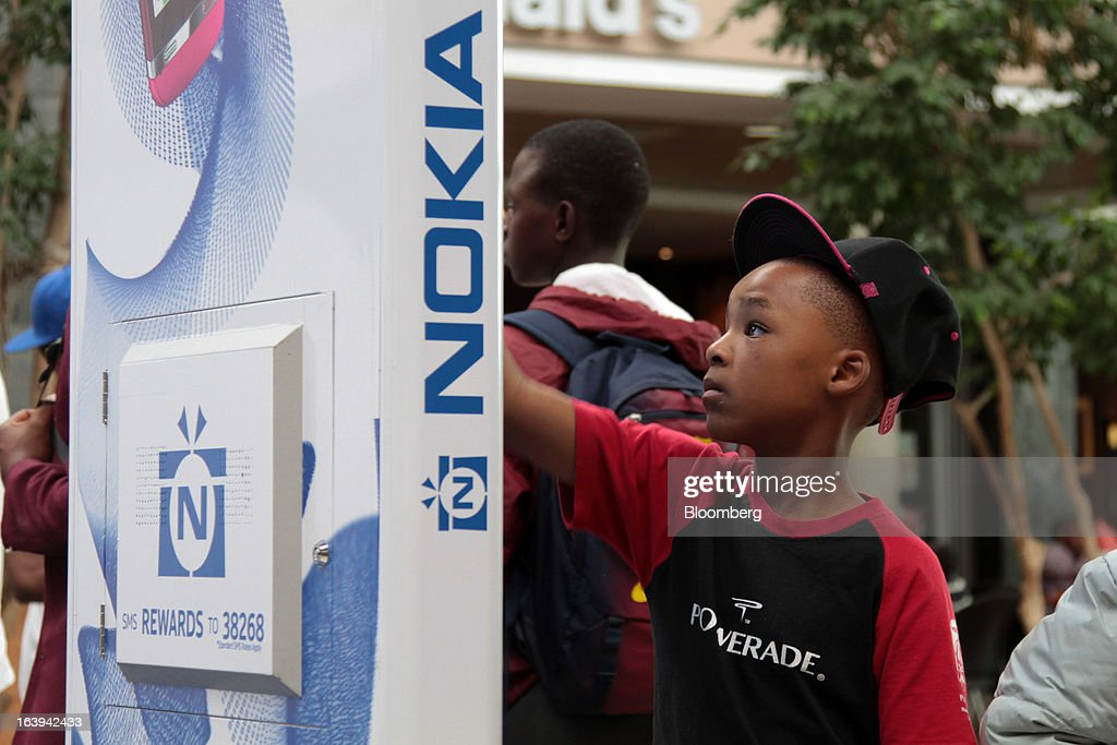 A child interacts with a touch screen during a promotional event for Asha smartphones by Nokia Oyj in Maponya Mall in Soweto, South Africa, on Saturday, March 16, 2013. Nokia, based in Espoo, Finland, introduced three phones for its Asha line, sold primarily in emerging markets. Photographer: Nadine Hutton/Bloomberg via Getty Images