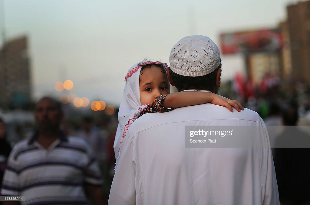 A child is carried down a street by a relative at the base for supporters of ousted president Mohamed Morsi on the third day of Ramadan, the sacred holy month for Muslims where many will fast from sun-up to sun-down on July 12, 2013 in Cairo, Egypt. Egypt continues to be in a state of political paralysis following the ousting of former President and Muslim Brotherhood leader Mohamed Morsi by the military. Adly Mansour, chief justice of the Supreme Constitutional Court, was sworn in as the interim head of state in a ceremony in Cairo on the morning of July 4.