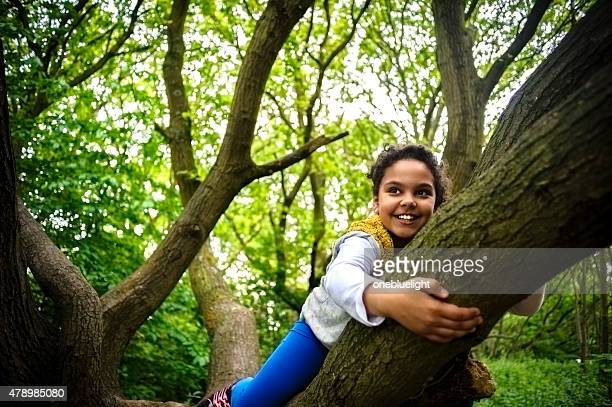 Child (8-9) Is Hanging On a Tree