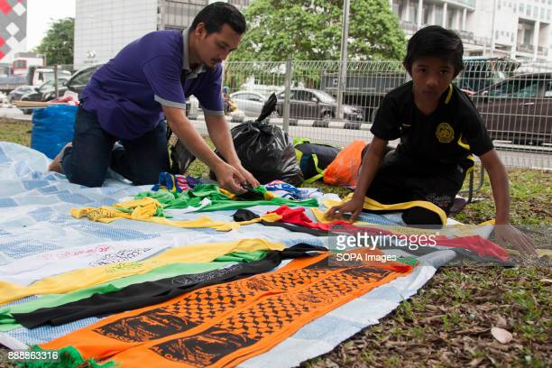 A child is seen helped his father to pack some merchandise after the rally finished Almost 1000 people gathered outside the United State Embassy at...